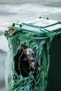 Burnt green garbage can Stock Photos