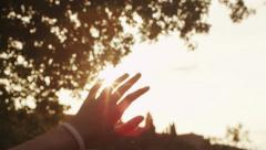 Kid Looking to the Sun through Fingers 4K Stock Footage