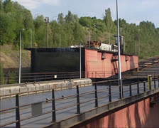 Ronquieres Inclined Plane Boatlift caisson with ship descends Stock Footage