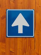 One way traffic sign on wooden wall Stock Photos