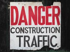 Old sign with text danger construction traffic Stock Photos