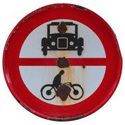 rusty old road sign with classic car and motorcycle - stock photo