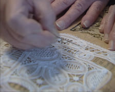Making needlepoint lace, verifying a pattern - close up Stock Footage