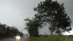 Rain storm with lightning on the road Stock Footage