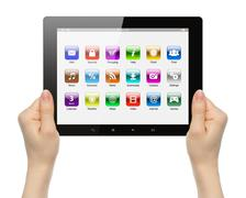 woman hands holding tablet pc with icons . - stock photo