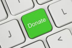 Green donate button. Stock Photos