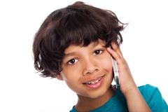 cute mixed race talking on mobile phone. - stock photo