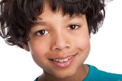 cute mixed race boy close up. - stock photo