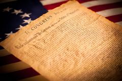 united states declaration of independence on flag background - stock photo