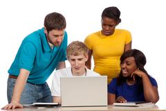 diverse group of college students/friends looking at a computer screen - stock photo