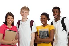 Multi-ethnic college students/friends with backpacks and books on a white bac Stock Photos