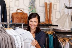Customer choosing shirt in clothing store Stock Photos