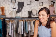 Smiling woman in boutique Stock Photos