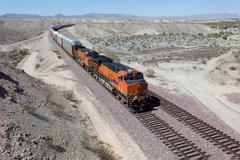 a speeding train on a railroad track - stock photo