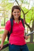 young, smiling college student outside - stock photo