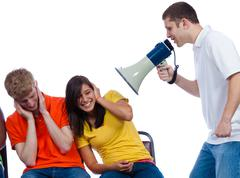 Young friends being yelled at by a bullhorn Stock Photos