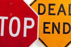 stop sign and dead end sign on a white background - stock photo