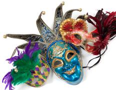 Assorted mardi gras masks on a white background Stock Photos