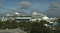 Wide shot of Cruise ship docked Stock Footage