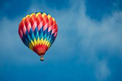Brightly colored hot air balloon with a sky blue background Stock Photos