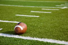 an american football on field - stock photo