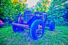 old rusted vehicles on farm land abandoned hdr - stock photo