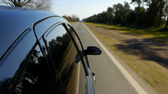 Driving a black car POV. Right side reference. Country road. - stock footage