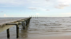 Pier with small waves - stock footage