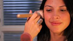 Woman applying makeup blush Stock Footage