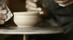Old Potter works in workshop Stock Footage