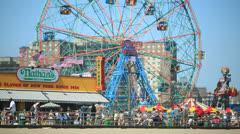 Coney Island boardwalk amusement park people walking Stock Footage