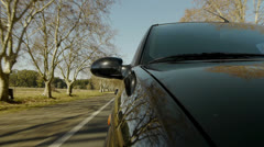Driving a car, windshield reflection. Hood side reference. Stock Footage