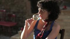 Woman drinking white wine Stock Footage