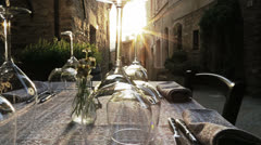 Table with wine glasses of wedding at sunset Stock Footage