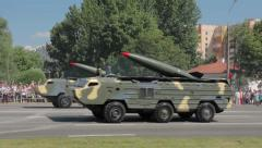 Military cars with a missiles go on the street Stock Footage