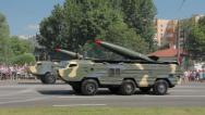 Stock Video Footage of Military cars with a missiles go on the street