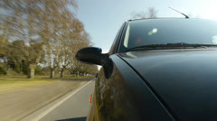 Driving a car, windshield reflection. Hood side reference. - stock footage