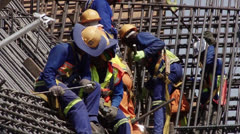 Tying Reinforcing steel civil construction NTSC - stock footage