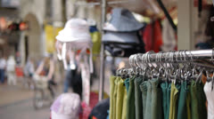 Outdoor stall selling hats and scarves. Stock Footage
