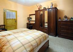 Orange bedroom with a double wood bed Stock Photos
