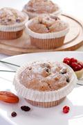 some small round fruitcakes with raisin. - stock photo