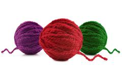Multi-colored balls of wool on a white background Stock Photos