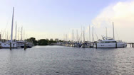 Stock Video Footage of Wide shot of sailboats and yacht in Tampa Bay