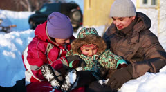 Portrait of a happy couple with a child in winter Stock Footage