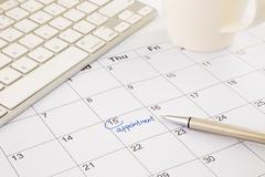appointment schedule on office table - stock photo