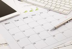 blank calendar on office table - stock photo