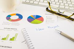 Create ideas for new project, graph and chart with blank paper on office tabl Stock Photos