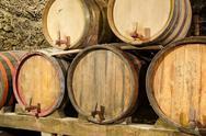 Wooden wine barrels in an underground cellar Stock Photos