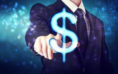 Businessman pointing dollar icon Stock Photos