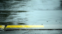 Rain drops falling on the road - stock footage